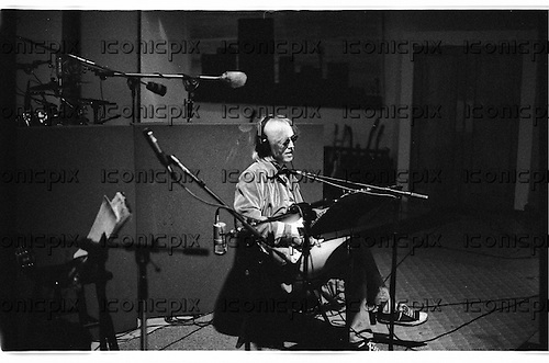"""JOHNNY CASH -  Tom Petty during the recording sessions for Johnny Cash's """"Unchained"""" CD Produced by Rick Rubin.   Photographed at Sound City Studios in Van Nuys, CA USA - January 26, 1996.  Photo © Kevin Estrada / Iconicpix"""