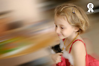 Little girl (6-7) running, holding cat, blurred motion (Licence this image exclusively with Getty: http://www.gettyimages.com/detail/200553553-001 )