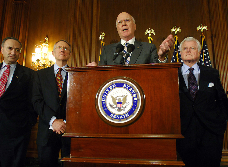01/24/06.ALITO NOMINATION--Senators Charles E. Schumer, D-N.Y., Senate Minority Leader Harry Reid, D-Nev., committee ranking Democrat Patrick J. Leahy, D-Vt., and Edward M. Kennedy, D-Mass., during a news conference after the Senate Judiciary Committee voted 10-8 along party lines Tuesday to approve the nomination of Samuel A. Alito Jr. to the Supreme Court. The full Senate will take up the nomination Wednesday; a close confirmation vote is expected within the next several days..CONGRESSIONAL QUARTERLY PHOTO BY SCOTT J. FERRELL
