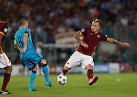 Barcellona's Andreas Iniesta and  AS Roma's Radja Nainggolan  during the Champions League Group E soccer match   at the Olympic Stadium in Rome September 16, 2015