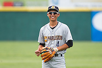 Gosuke Katoh (4) of the Charleston RiverDogs warms up in the outfield prior to the game against the Hickory Crawdads at L.P. Frans Stadium on May 25, 2014 in Hickory, North Carolina.  The RiverDogs defeated the Crawdads 17-10.  (Brian Westerholt/Four Seam Images)