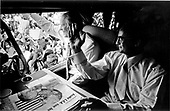 "United States President Gerald R. Ford and Mexican President Luis Echeverra return the greetings of the Magdalena, Mexico crowd from Echeverra's Presidential autobus ""Miguel Hidalgo"" on October 21, 1974.  The brief visit to Mexico was the first foreign trip of the Ford Administration.  On the table before the two leaders is a Mexican newspaper headlining the meeting of the two presidents.<br /> Mandatory Credit: David Hume Kennerly / White House via CNP"
