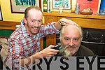 Brendan O'Shea - 'A Cut Above' hair studio, puts the final cut to Denis O'Sullivan's beard in Craineens Bar, Cahersiveen, on Friday night last.  Denis underwent the debearding in aid of the 'Cunamh' project and St. Ann's Hospita,l Cahersiveen.