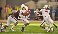 STAFF PHOTO BEN GOFF  @NWABenGoff -- 09/27/14  Arkansas running back Jonathan Williams breaks the tackle of Texas A&M linebacker Donnie Baggs, left, as Arkansas wide receiver Keon Hatcher blocks Texas A&M cornerback De'Vante Harris during the fourth quarter of the Southwest Classic in AT&T Stadium in Arlington, Texas on Saturday September 27, 2014.