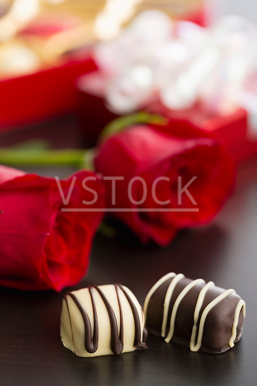 Chocolate candies and red roses
