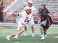 College Park, MD - April 15, 2018: Maryland Terrapins Bubba Fairman (2) runs pass a Rutgers Scarlet Knights defender during game between Rutgers and Maryland at  Capital One Field at Maryland Stadium in College Park, MD.  (Photo by Elliott Brown/Media Images International)