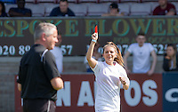 The Referee is shown a red card by Robyn Regan (Singer) during the 'Greatest Show on Turf' Celebrity Event - Once in a Blue Moon Events at the London Borough of Barking and Dagenham Stadium, London, England on 8 May 2016. Photo by Andy Rowland.