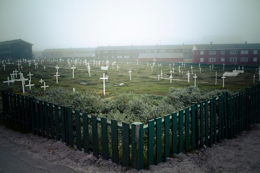 A graveyard and public housing estate in the capital of Greenland, Nuuk, August 2011. Photo: Ed Giles.