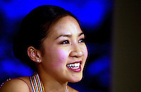 Skater MICHELLE KWAN press interview portraits after winning gold in Ladies at 2001 World Championships at Nice, France in March, 2001..(Photo by Tom Theobald).