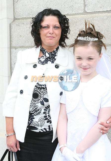 Josephine and Madeline O'Brien at St Brigid's NS Communion in the Lourdes Church....Photo NEWSFILE/Jenny Matthews.(Photo credit should read Jenny Matthews/NEWSFILE)....This Picture has been sent you under the condtions enclosed by:.Newsfile Ltd..The Studio,.Millmount Abbey,.Drogheda,.Co Meath..Ireland..Tel: +353(0)41-9871240.Fax: +353(0)41-9871260.GSM: +353(0)86-2500958.email: pictures@newsfile.ie.www.newsfile.ie.FTP: 193.120.102.198.