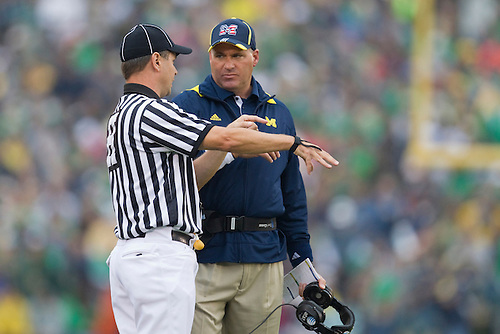 Michigan head coach Rich Rodriguez discusses call with official during NCAA football game between the Notre Dame Fighting Irish and the Michigan Wolverines.  Michigan defeated Notre Dame 28-24 in game at Notre Dame Stadium in South Bend, Indiana.