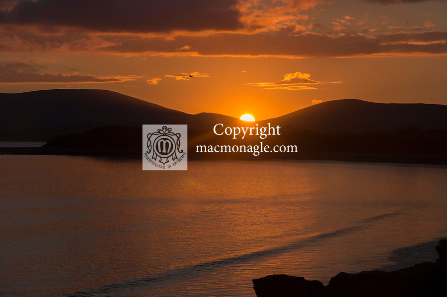 The sun sets behind the hills of Emlaghmore outside Waterville in County Kerry at the weekend.<br /> The forecast is for good weather this week.<br /> Photo: Don MacMonagle