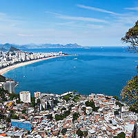 Dwelling conditions at Favela do Vidigal, Ipanema and Leblon beaches in background, the most affluent districts of the city.