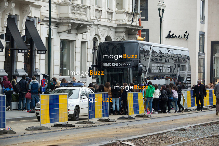 """Justin Bieber touring in Belgium - Justin Bieber arrived from France in Belgium-Brussels,  on April 9th at 4 am with his black/grey touring bus """"  Beat the streets """"..He checked into the  """" Steigenberger """"  hotel in Brussels. A few hours later, his fans were surrounding the front and back entrance of his hotel, that the security of the hotel could not handle such a craziness and had to get some big help from the brussels police. About 40 police officers arrived to surround the hotel to protect the star who had two concerts in the city of Antwerp. But Justin asked the police to leave, which they did after a while!! Justin kept hiding in the hotel between the fitness center kept opened only for him, as well the swimming pool where he did some water polo with his musicians. The bar of the hotel even got closed to the guests of the hotel around 6pm, to let justin enjoying the bar. On the first day of his concert, Justin escaped his fans by jumping from his Mercedes van into his tour bus, hided by his bodyguards. Justin's musicians even played the piano at the piano bar  of the hotel, singing Elton John's songs! It's only on his 3rd and last day in Brussels  ( April11th ) that Justin Bieber finally agreed to meet with his fans on the street. Brussels, April 10th & 11th, 2013..Pictured : fans waiting for Justin Bieber in front of his Brussel's hotel"""