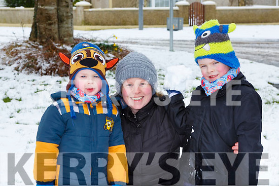 Gillian, Oisin and  Charlie Tarrant playing in the snow in Castleisland on Friday