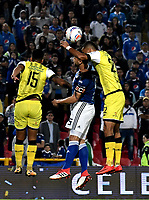 BOGOTA - COLOMBIA - 22 – 03 - 2018: Andres Cadavid (Cent.) jugador de Millonarios disputa el balón con Luciano Ospina (Der.) jugador de Alianza Petrolera, durante partido aplazado de la fecha 8 entre Millonarios y Alianza Petrolera, por la Liga Aguila I 2018, jugado en el estadio Nemesio Camacho El Campin de la ciudad de Bogota. / Andres Cadavid (C) player of Millonarios vies for the ball with Luciano Ospina (R) player of Alianza Petrolera, during a posponed match of the 8th date between Millonarios and Alianza Petrolera, for the Liga Aguila I 2018 played at the Nemesio Camacho El Campin Stadium in Bogota city, Photo: VizzorImage / Luis Ramirez / Staff.