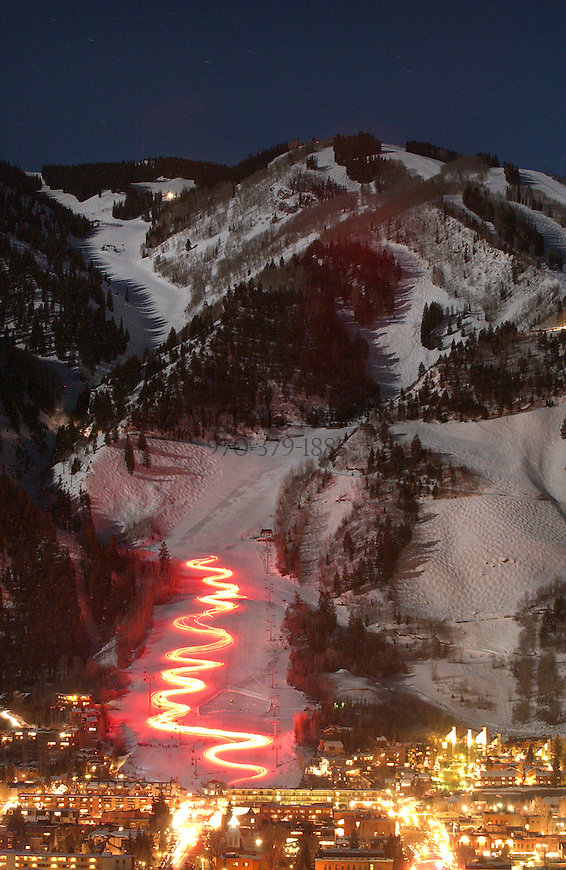 Torchlight descent on Aspen Mountain during Winterskol celebration in Aspen, Colorado. © Michael Brands