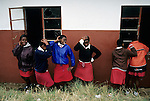 NGUDWINI, SOUTH AFRICA - SEPTEMBER 10: Nobule Ngema, age 16, (blue jacket) dances with her friends outside the class room of their high school on September 10, 2004 in Ngudwini village in rural Natal, South Africa. She's preparing to travel to the annual Reed Dance where about 20.000 fellow maidens from all over South Africa gathers to dance for the Zulu King. The girls come to the kingdom to declare their virginity and the ceremony encourages girls and young women to abstain from sexual activity to curb the spread of HIV-Aids. Its Nobuhle's first trip and she's already has three virginity certificates as she was tested in the village the last three years. .(Photo: Per-Anders Pettersson)......