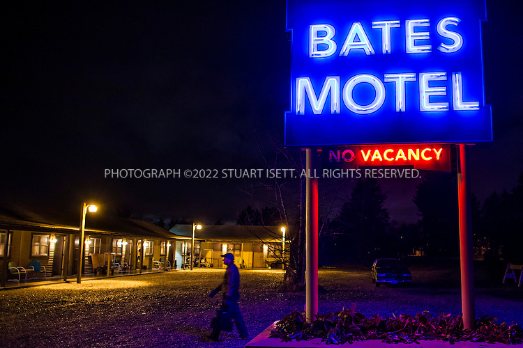"""1/28/2013--Aldergrove, British Columbia, Canada..New York Times report Neil Genzlinger on the set of """"Bates Motel"""", an upcoming television series on A&E. The series is inspired by Alfred Hitchcock's Psycho, and will depict the life of Norman Bates (played by Freddie Highmore) and his mother Norma (played by Vera Farmiga) prior to the events portrayed in Hitchcock's film. A&E chose to skip a pilot of the series, and ordered a 10-episode first season. The series was filmed in Aldergrove, British Columbia, close to the US border and near Vancouver. It's scheduled to debut in March..Here: Neil walks across the parking lot of the set to the main office..©2013 Stuart Isett. All rights reserved."""