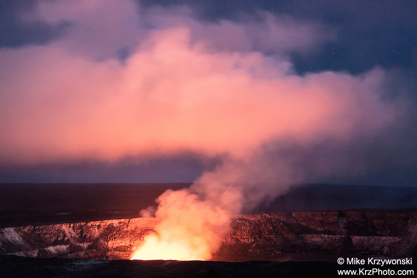 Colorful glowing plume of smoke rising out of Halema'uma'u Crater at night in Hawaii Volcanoes National Park, Big Island<br />
