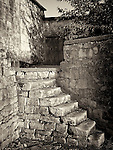 Crumbling stone steps leading up into an old house in Cyprus