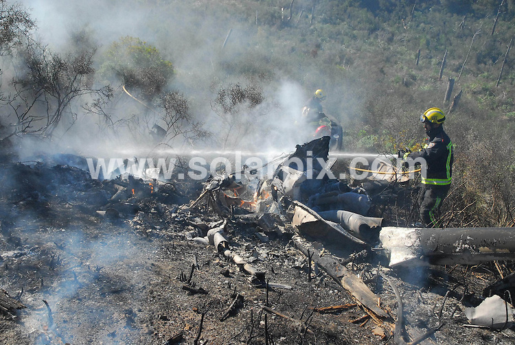 **ALL ROUND EXCLUSIVE PICTURES FROM SOLARPIX.COM**.**FULL STORY BY TAG MEDIA TOM WORDEN TEL:+34680152448** **DOUBLE SPACE RATES APPLY**                                              .**WORLDWIDE SYNDICATION RIGHTS**                                                                                  .An MD 5oo Helicopter crashed today in Andrax on the Spanish holiday island of Mallorca (Majorca) killing two British people.The two men were killed instantly when the aircraft plummeted to the ground after bursting into flames in the air. The victims were named as Mark Blaver-Mann and Alistair Evans.                                                      .This pic:   Rescue teams and wreckage                                                                                           JOB REF: 14180       JGM       DATE: 12.11.2011                                                           **MUST CREDIT SOLARPIX.COM OR DOUBLE FEE WILL BE CHARGED**                                                                      **MUST AGREE FEE BEFORE ONLINE USAGE**                               **CALL US ON: +34 952 811 768 or LOW RATE FROM UK 0844 617 7637**