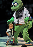 5 September 2008: Vermont Lake Monsters' mascot Champ entertains a young fan during a game against the Oneonta Tigers at Centennial Field in Burlington, Vermont. The Lake Monsters fell to the Tigers 10-4. Mandatory Photo Credit: Ed Wolfstein Photo