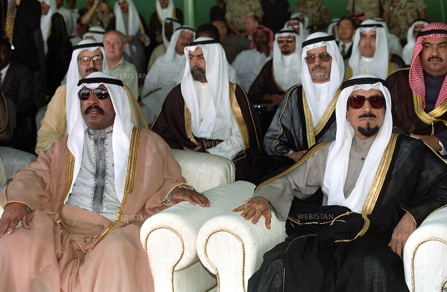 Sheikh Jaber Al-Ahmad Al-Jaber Al-Sabah, Emir of Kuwait (right), and Sheikh Saad Al-Abdullah Al-Salim Al-Sabah (left) at the celebration of extinguishing the last oil well set ablaze by the Iraqi forces, in Al Ahmadi, nine months after the withdrawal of Iraqi troops from Kuwait. They are surrounded by other members of the Al-Sabah clan, the royal family of Kuwait. ..Sheikh Jaber Al-Ahmad Al-Jaber Al-Sabah was born 1928; he was proclaimed the 13th Amir from the Al-Sabah family on December 31, 1977. When he died on 15 January 2006, his distance cousin, Sheikh Saad Al-Abdallah Al-Sabah, succeeded him for a short reign of ten days from January 15 to January 24, 2006. He abdicated his position as the Emir of Kuwait, due to his state of health. He suffers from cancer and colon problems. On January 24, 2006, the Kuwaiti parliament voted Saad out of office, moments before an official letter of abdication was received. Finally, the Kuwaiti Cabinet nominated Prime Minister Sheikh Sabah Al-Ahmad Al-Jaber Al-Sabah for the position of Emir of Kuwait.