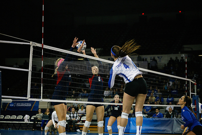 Freshman Anni Thomasson (4) spikes the ball over the net during the University of Kentucky women's volleyball game vs. Duquesne University at Memorial Coliseum  in Lexington, Ky., on Saturday, December 7, 2013. Kentucky defeated Duquesne 3-0. Photo by Adam Pennavaria | Staff