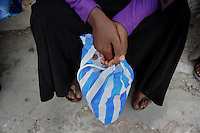 The girls carry their basketball boots in plastic bags inorder for the Al- shaabaab not to see that they are doing sports....Death or Play. Women´s Basketball in Mogadishu.Women's basketball? In Europa and the U.S., we take it for granted. But consider this: In Mogadishu, war-torn capital of Somalia, young women risk their lives every time they show up to play..Suweys, the captain of the Somali women´s basketball team, and her friends play the sport of the deadly enemy, called America. This is why they are on the hit list of the killer commandos of Al Shabaab, a militant islamist group, that has recently formed an alliance with the terrorist group Al Qaeda and control large swathes of Somalia...Al Shabaab, who sets bombs under market stands, blows up cinemas, and stones women, has declared the female basketball players ?un-islamic?. One of the proposed punishments is to saw off their right hands and left feet. Or simply: shoot them...Suweys´ team trains behind bullet-ridden walls, in the ruins of the failed city of Mogadishu - protected by heavily armed gun-men. The women live in constant fear of the islamist killer commandos. Stop playing basketball? Never, they say..Women´s basketball in the world´s most dangerous capital..