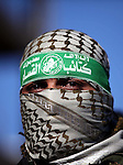 A Member of Hamas armed wing poses for a picture during a news conference to condemn the decision of an Egyptian court that banned Hamas' armed wing, in Gaza City February 5, 2015. An Egyptian court last week banned Hamas' armed wing and listed it as a terrorist organization, prompting Hamas to reject Egypt as a mediator between Israel and the Palestinians, a role it has played for decades. Photo by Ashraf Amra