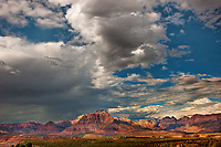 799800169 thunderstorms and clouds form over west temple and zion geological formations in this view from a backcountry scenic byway near hurricane utah