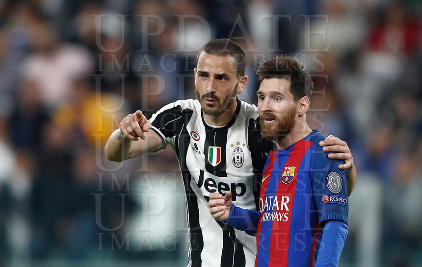 Football Soccer: UEFA Champions UEFA Champions League quarter final first leg Juventus-Barcellona, Juventus stadium, Turin, Italy, April 11, 2017. <br /> Juventus Leonardo Bonucci (l) speaks with Barcellona Lionel Messi (r) during the Uefa Champions League football match between Juventus and Barcelona at the Juventus stadium, on April 11 ,2017.<br /> UPDATE IMAGES PRESS/Isabella Bonotto