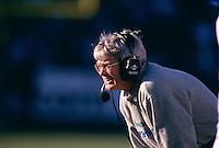 OAKLAND, CA -  Head coach Dennis Erickson of the Seattle Seahawks in action during a game against the Oakland Raiders at the Oakland Coliseum in Oakland, California in 1998.  Photo by Brad Mangin