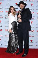 PASADENA, CA - SEPTEMBER 27: Actress Jessica Alba and Director Robert Rodriguez pose in the press room during the 2013 NCLR ALMA Awards held at Pasadena Civic Auditorium on September 27, 2013 in Pasadena, California. (Photo by Xavier Collin/Celebrity Monitor)