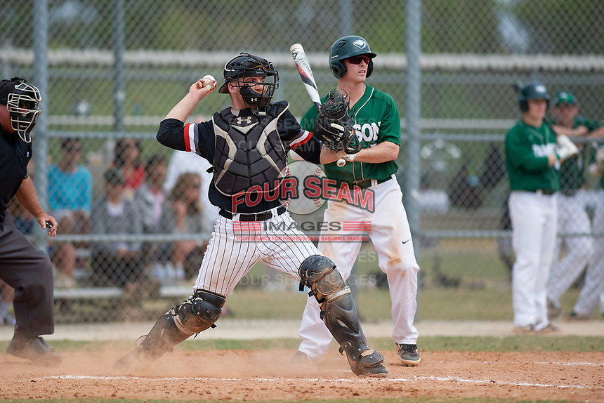 Edgewood Eagles catcher Jacob Popp (20) throws down to second base as Connor Gill (7) looks on during a game against the Babson Beavers on March 18, 2019 at Lee County Player Development Complex in Fort Myers, Florida.  Babson defeated Edgewood 23-7.  (Mike Janes/Four Seam Images)