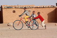 Children plays on December 11, 2003, in the Saharawi refugee camps. Saharawi people have been living at the refugee camps of the Algerian desert named Hamada, or desert of the deserts, for more than 30 years now. Saharawi people have suffered the consecuences of European colonialism and the war against occupation by Moroccan forces. Polisario and Moroccan Army are in conflict since 1975 when Hassan II, Moroccan King in 1975, sent more than 250.000 civilians and soldiers to colonize the Western Sahara when Spain left the country. Since 1991 they are in a peace process without any outcome so far. (Ander Gillenea / Bostok Photo)