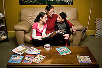 Martha Woodard (cq), and her children Ashley Woodard (cq, age 11, left), and John Woodard Jr. (cq, age 9) read together at home in Laredo, Texas, US, Thursday, Dec. 10, 2009. Martha, a native Spanish speaker from Mexico, is learning English to be able to help her children with homework and reading, which is always in English...PHOTOS/ MATT NAGER