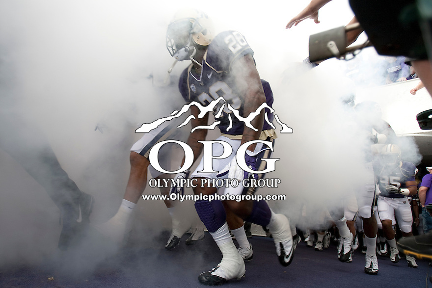 Sept 24, 2011:  Washington cornerback #28 Quinton Richardson runs out from the tunnel with teammates before the game against Cal.  Washington defeated Cal 31-23 at Husky Stadium in Seattle, Washington...