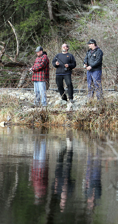 Torrington, CT-042013MK02 (from left) Jason with his father Joel and brother Josha Johnson share a light moment while fishing on Still River Pond in Torrington Saturday morning during the opening day of the 2013 fishing season in Connecticut. Michael Kabelka / Republican-American.