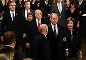 Former US President George W Bush (2R) and former first lady Laura Bush walk past the casket (unseen) bearing the remains of former US President George H.W. Bush at the US Capitol during the State Funeral in Washington, DC, December 3, 2018. - The body of the late former President George H.W. Bush travelled from Houston to Washington, where he will lie in state at the US Capitol through Wednesday morning. Bush, who died on November 30, will return to Houston for his funeral on Thursday. (Photo by Brendan SMIALOWSKI / AFP)