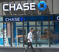 A Chase bank branch is pictured in New York City, NY Thursday August 4, 2011. JPMorgan Chase Bank, N.A., doing business as Chase, is a national bank that constitutes the consumer and commercial banking subsidiary of financial services firm JPMorgan Chase.
