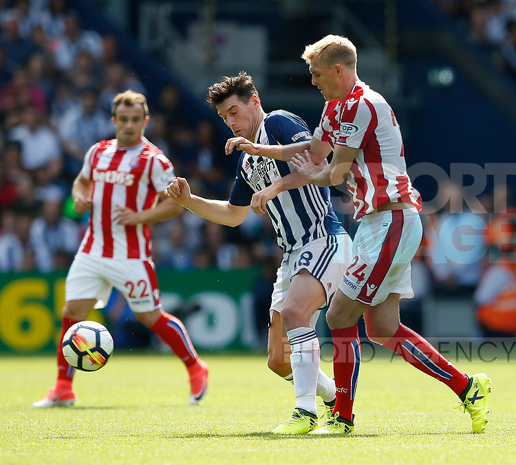 Gareth Barry of West Bromwich Albion and Darren Fletcher of Stoke City during the premier league match at the Hawthorn's Stadium, West Bromwich. Picture date 27th August 2017. Picture credit should read: Simon Bellis/Sportimage