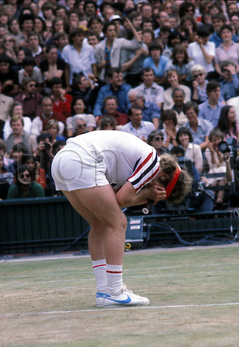 July 1980: American player JOHN McENROE holds his head in his hands in anguish during his Wimbledon Men's Singles Final defeat to Borg Photo: Leo Mason/Action Plus...tennis loser losing disappointment lose man 8007