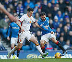 Jon Toral drags the ball past Carl McHugh