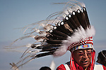 Man in a headdress braves the wind.