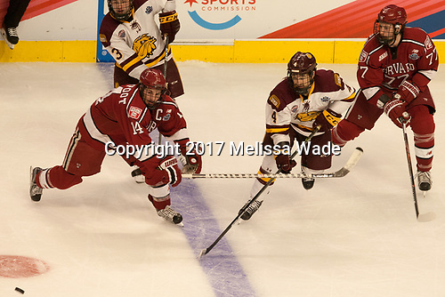 Alexander Kerfoot (Harvard - 14), Dan Molenaar (UMD - 3), Neal Pionk (UMD - 4), Lewis Zerter-Gossage (Harvard - 77) - The University of Minnesota Duluth Bulldogs defeated the Harvard University Crimson 2-1 in their Frozen Four semi-final on April 6, 2017, at the United Center in Chicago, Illinois.