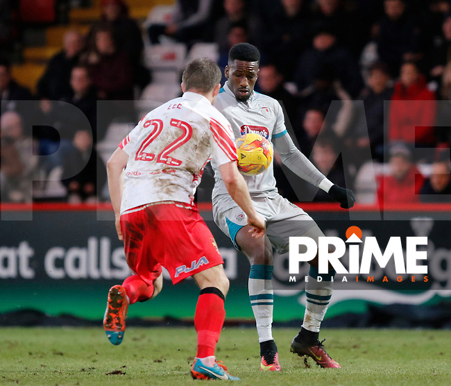 Grimsby's Omar Bogle faces Stevenage's Charlie Lee during the Sky Bet League 2 match between Stevenage and Grimsby Town at the Lamex Stadium, Stevenage, England on 28 January 2017. Photo by Carlton Myrie / PRiME Media Images.