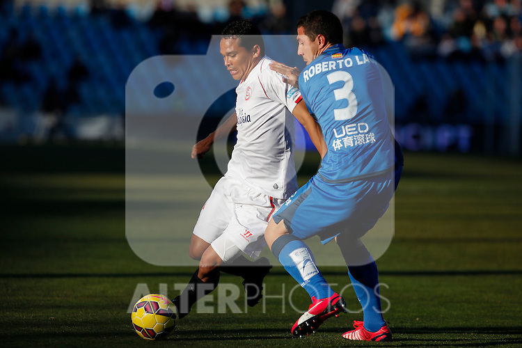 Getafe´s Roberto Lago (R) and Sevilla´s Bacca during 2014-15 La Liga match at Alfonso Perez Coliseum stadium in Getafe, Spain. February 08, 2015. (ALTERPHOTOS/Victor Blanco)