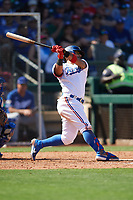 Rougned Odor (12) of the Texas Rangers follows through on a swing during a Cactus League Spring Training game against the Los Angeles Dodgers on March 8, 2020 at Surprise Stadium in Surprise, Arizona. Rangers defeated the Dodgers 9-8. (Tracy Proffitt/Four Seam Images)